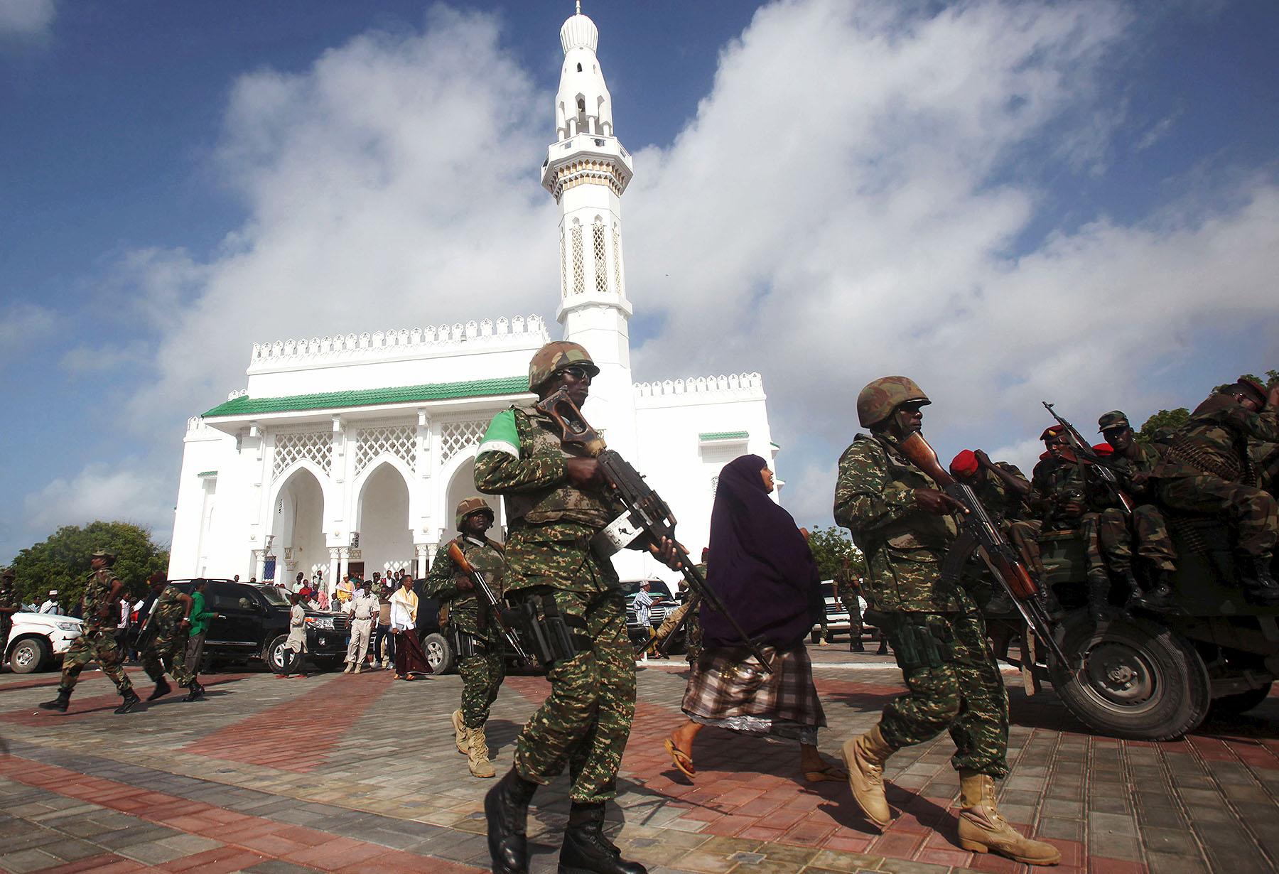 Soldiers serving in the African Union Mission in Somalia patrol outside a Mosque.