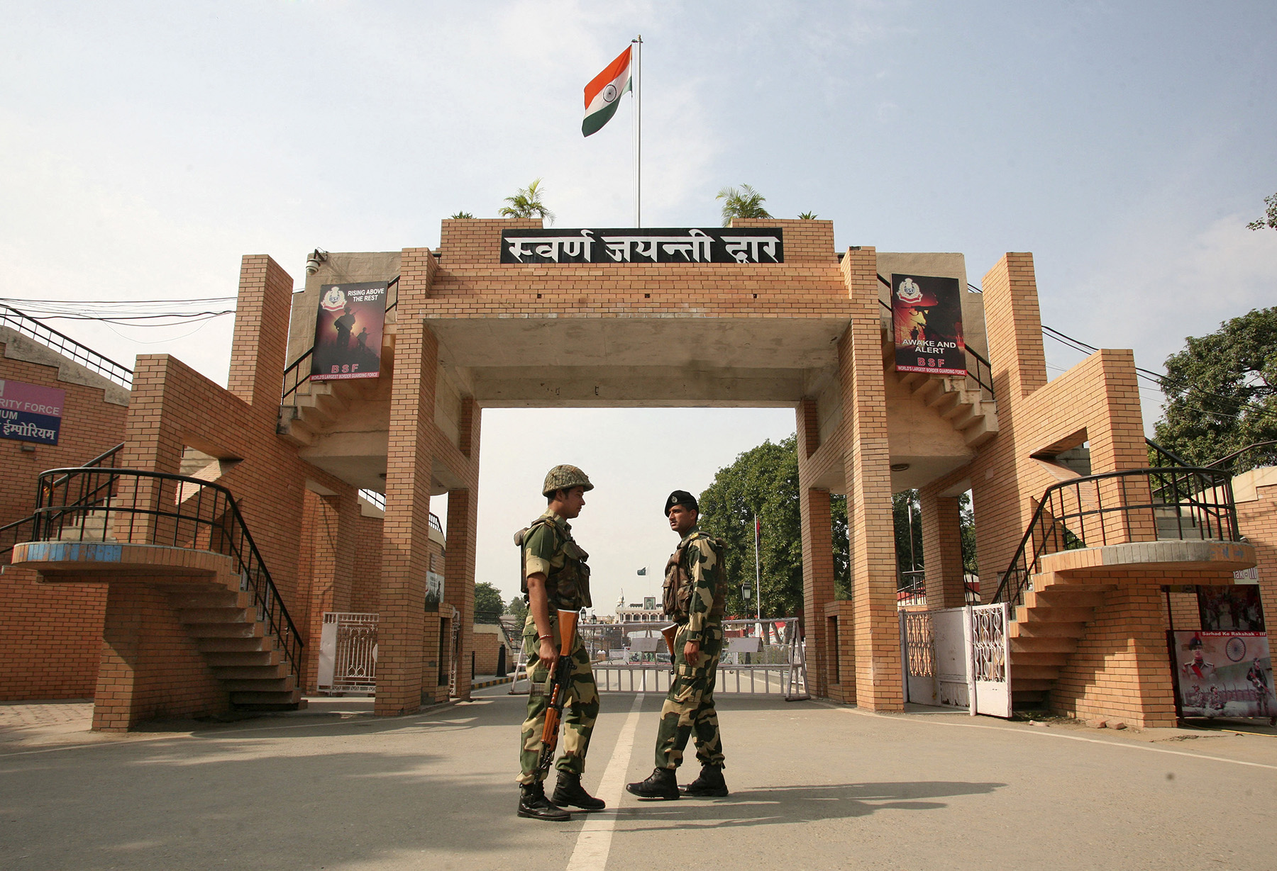 Indian border security force soldiers prtrol in front of Wagah border gate.