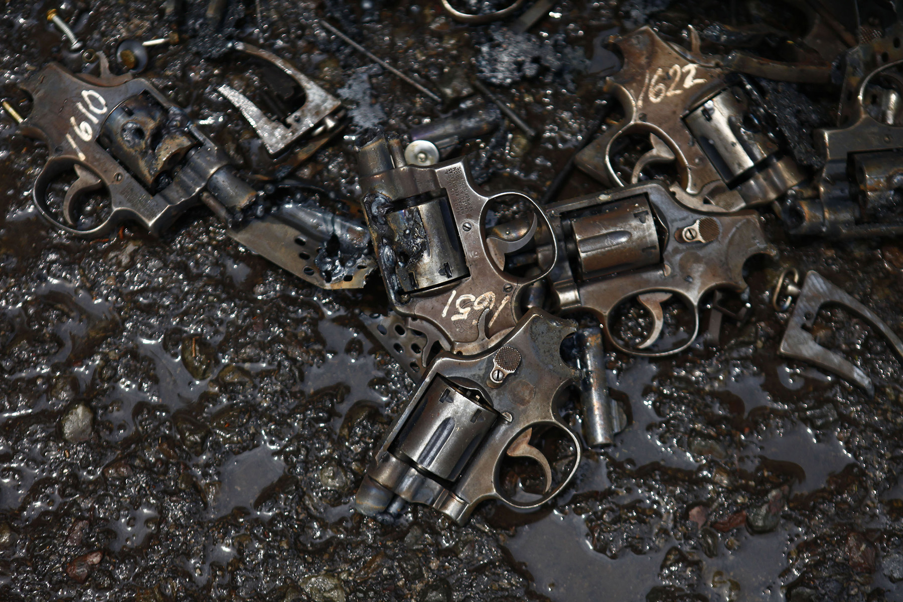 Parts of confiscated weapons by national security authorities are seen on a floor after they were destroyed at a military zone of Mexico City .